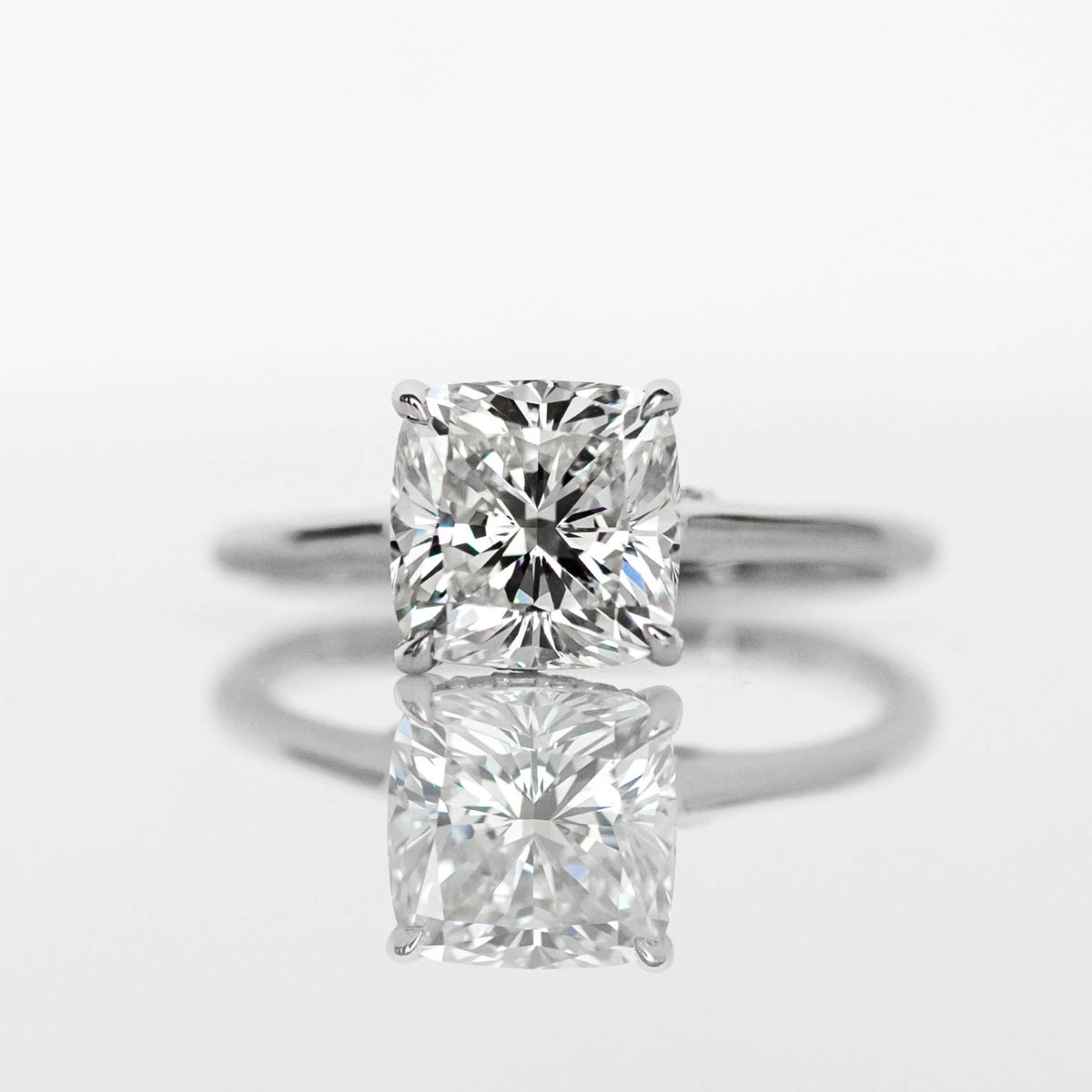 Cushion Cut DBK Classic Solitaire Setting With Diamond Basket & Bridge  In White Gold